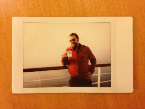 At Sea: Leaning with mug and orange sweater, 2