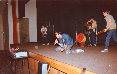 """Dave Olson with pals performing Sex Pistols """"air band"""" at a church in Surrey"""
