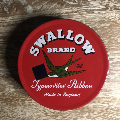 Items: stationery, typewriter ribbon (Swallow, made in England, red tin)