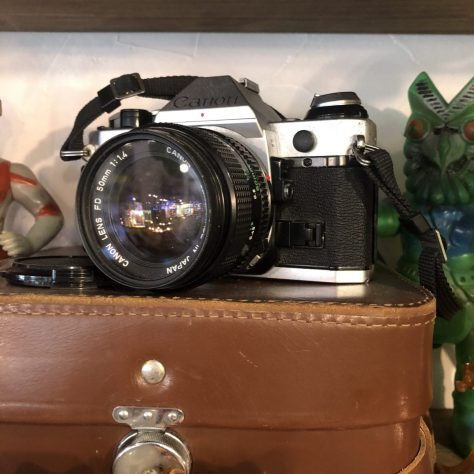 Artifacts: camera, Canon, 35mm, black/silver (in a coffee shop in Nozawa Onsen)