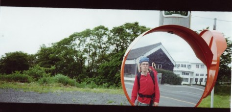 Japan hitch-hiking: killing time while waiting for a ride setting up photos in the convex mirrors which help drivers see oncoming traffic