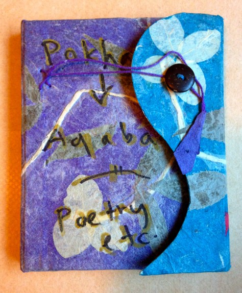 Journal: Pokhara > Aqaba / poetry, 2017 (purple flower paper maché from Nepal cover)