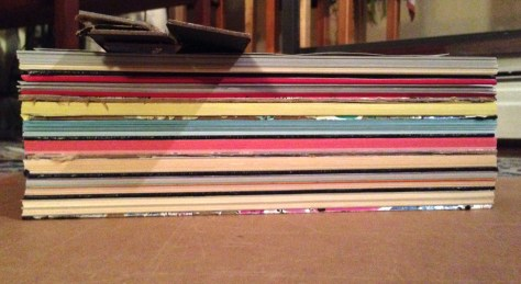 Scrapbook: assembly / stack of books (writing block detail)