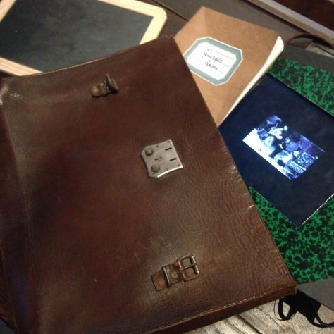 Hergé's leather satchel and notebooks for reference sketches and ideas  – Hergé / Tintin artifacts in Québec City