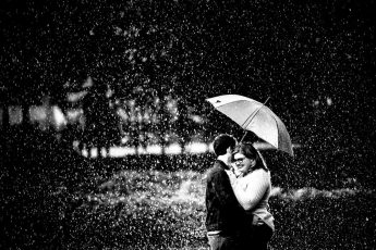 Couple Rain Engagement photo at pullen park