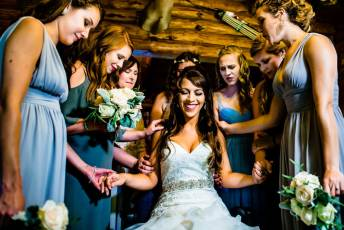 bridesmaids praying for bride on wedding day