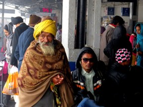 A land of contrast. Old man and hipster at the Agra train station.