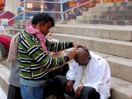 Many pilgrims get their head shaved before bathing in the Ganges.