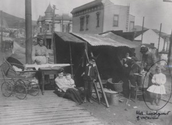 Group portrait of refugees at street kitchen. California Historical Society