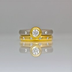 Modern engagement rub-over set diamond