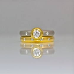 Modern engagement rub-over set diamond