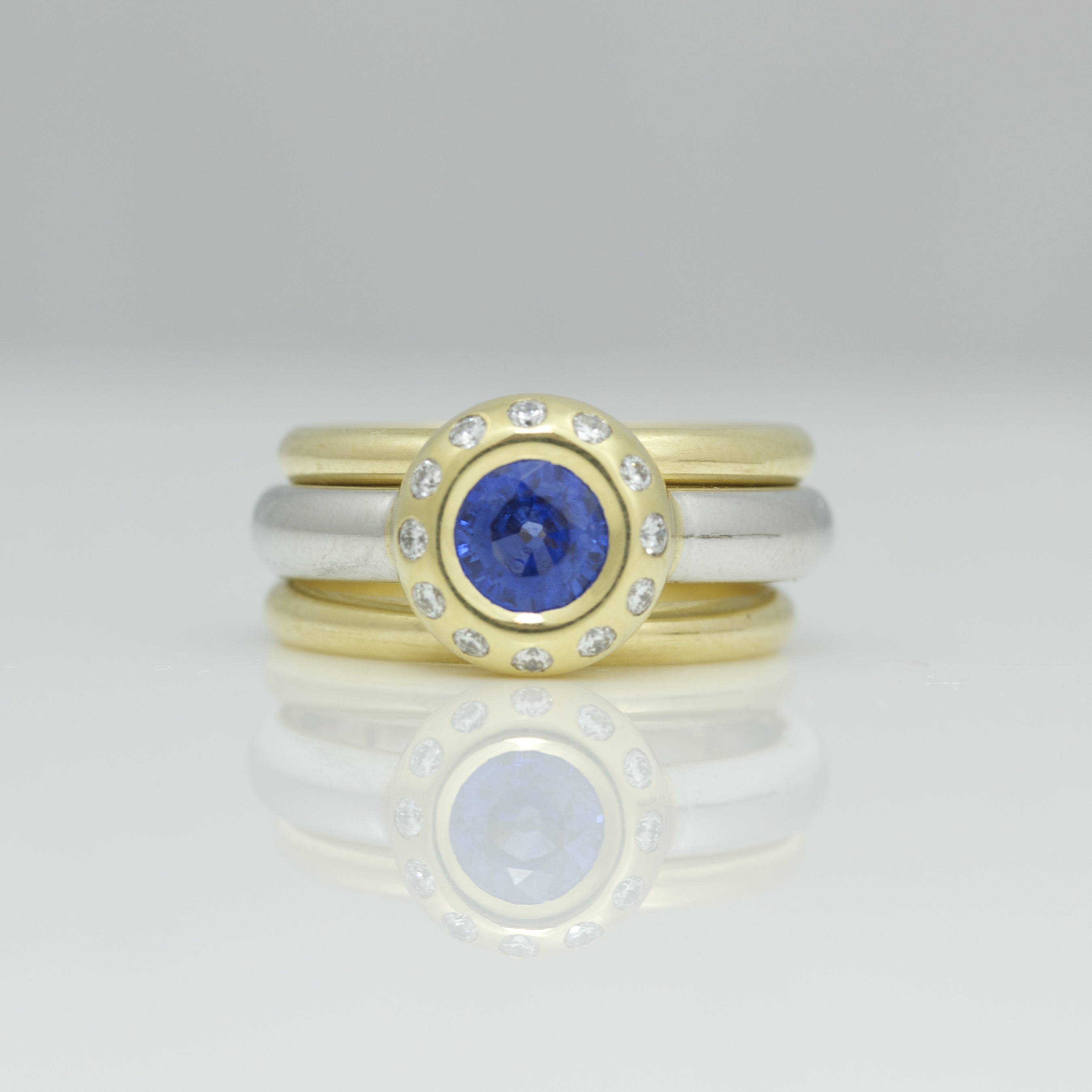 4db8a4418e824 Sapphire & diamond diamond rub-over set in 18ct yellow gold & platinum ring