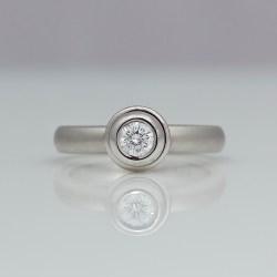 Platinum diamond rub-over set contemporary solitaire