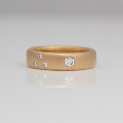 Contemporary flush set diamond rose gold ring