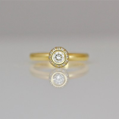 Contemporary engagement diamond gold ring
