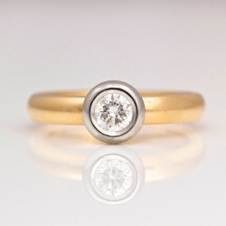 contemporary rub-over set engagement ring