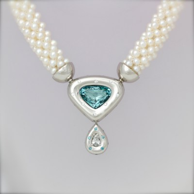 Blue & white diamond necklace in platinum on pearls.
