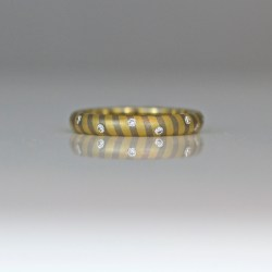 Bespoke contemporary 18ct gold wedding eternity ring