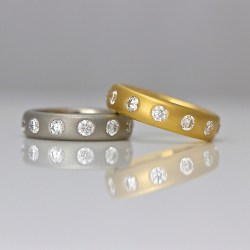 Contemporary diamond eternity ring yellow gold platinum.
