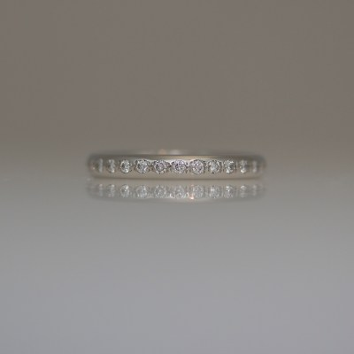 Narrow Platinum diamond set ring