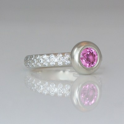 Pink sapphire on diamond set platinum ring