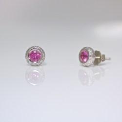 Diamonds set around pink sapphire, platinum ear-studs