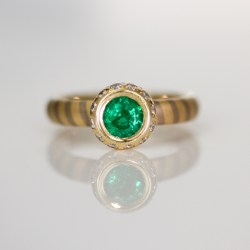 Modern emerald and diamond ring