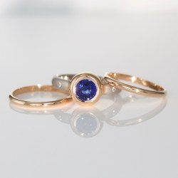 Sapphire rub-over set in rose gold, on a platinumand rose gold stacking ring set