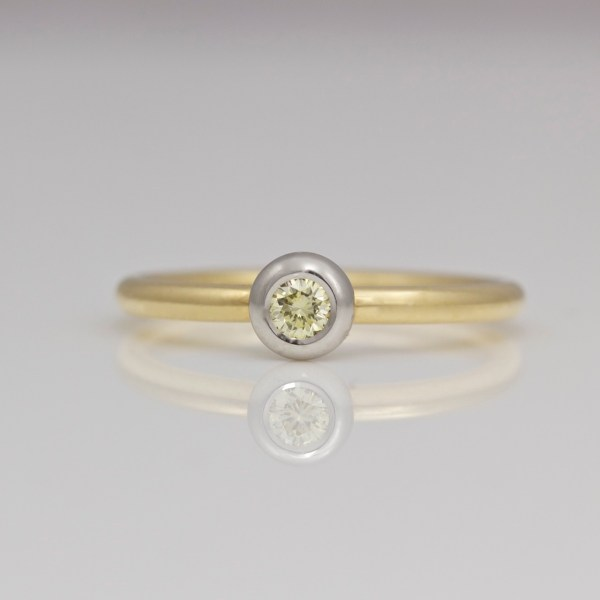 Natural yellow diamond rub-over set in platinum, gold ring