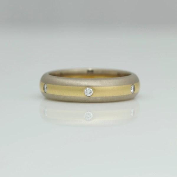 Diamonds flush set in 18ct gold center stripe ring 0711