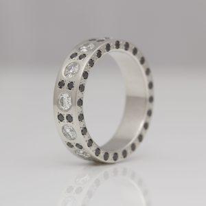 Platinum ring with black & white diamonds on all edges