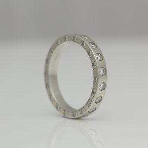 Platinum ring with diamonds set on all edges