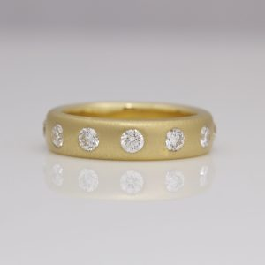 Contemporary diamond eternity ring yellow gold