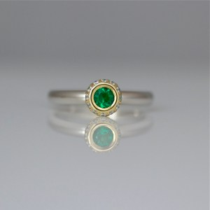Emerald & diamond halo ring