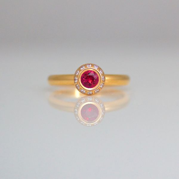 Ruby diamond rose gold halo ring