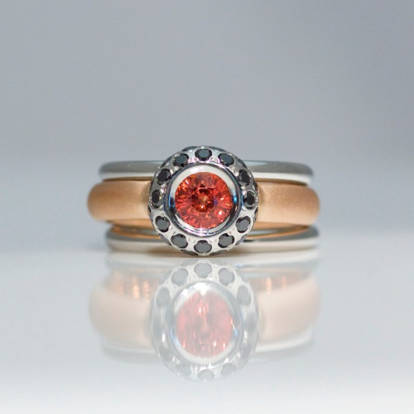 Orange sapphire & black diamond low set rub-over triple ring