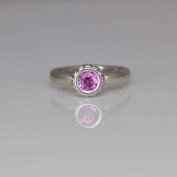 Pink sapphire diamond halo ring