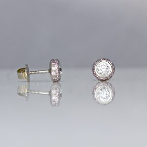 Pink and white diamond ear-studs.