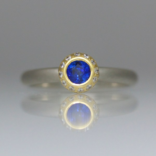 Sapphire rub-over set with diamond halo ring