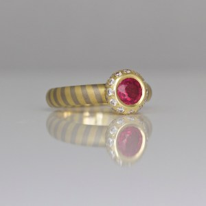 Ruby framed with diamonds diagonal striped ring