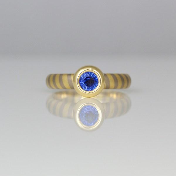 Sapphire rub-over set in yellow gold on 18ct diagonal stripe ring 0960 David Ashton