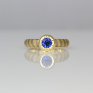 Sapphire rub-over set in yellow gold on 18ct diagonal stripe ring 0960 David Ashton