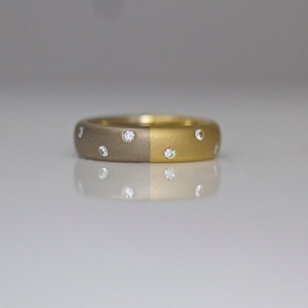 18ct yellow & white gold wide ring with random flush set diamonds