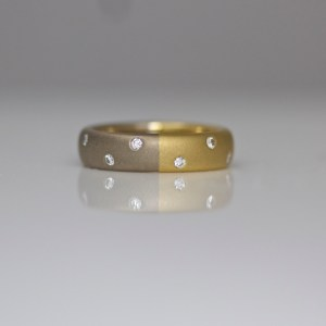 18ct yellow & white gold wide ring with random flush set diamonds