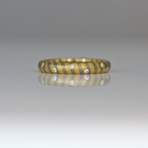 Diagonal stripe ring with flush set diamonds