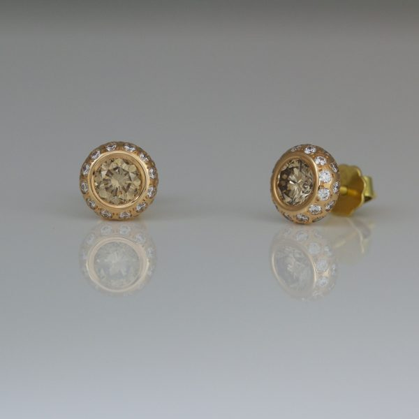 Pink champagne diamonds in rose gold ear-studs.