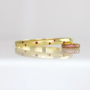 Rubies flush set in 18ct yellow gold bangle