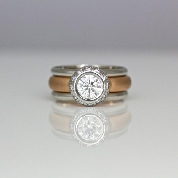 Modern diamond halo ring 1009 David Ashton
