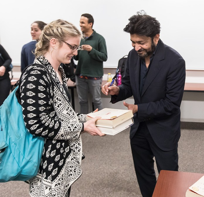 Dr. Siddhartha Mukherjee signs books for UCSB student 2/23/17 UCSB Life Sciences 4301