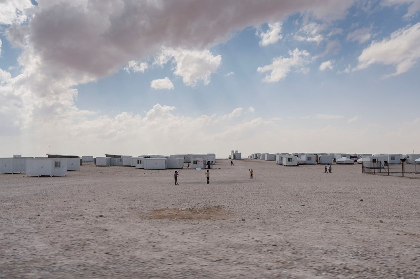 A newly pitched tent at the edge of Za'atari RC. Most new arrivals are initially housed in tents and have to wait until a prefab unit becomes available. The camp is set in inhospitable desert and the surroundings are bleak. With few barriers to protect against the relentless wind and dust, many are suffering from severe respiratory conditions, as well as pneumonia and dehydration during the dry season.